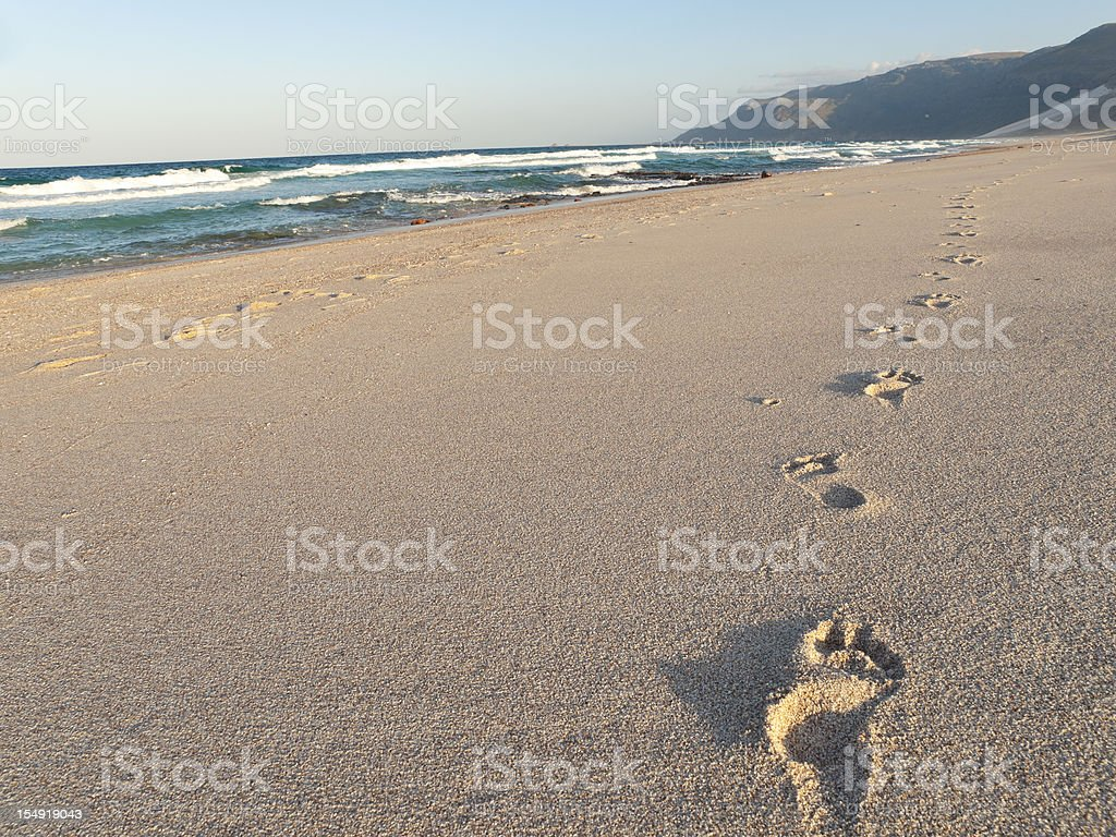 Footprints in the sand, Shoab beach, Soqotra, Yemen. stock photo