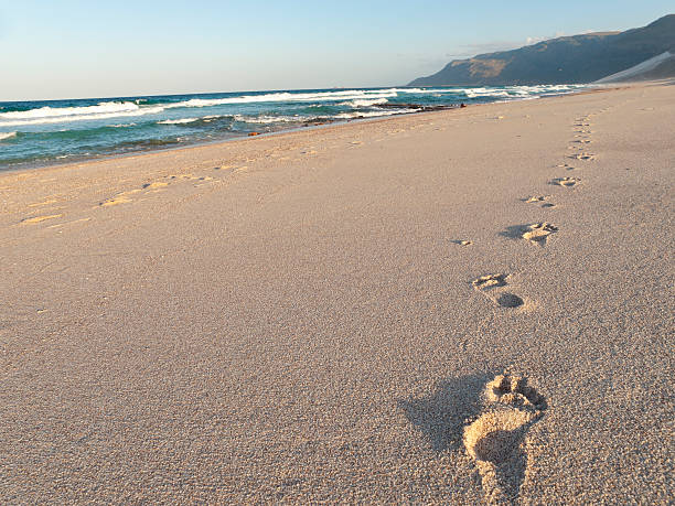 Footprints in the sand, Shoab beach, Soqotra, Yemen. stock photo