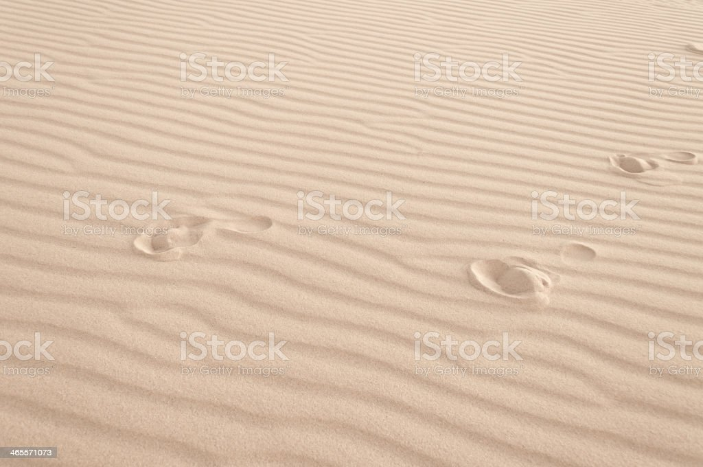 Footprints in the sand. White sand dune. Mui Ne. Vietnam stock photo