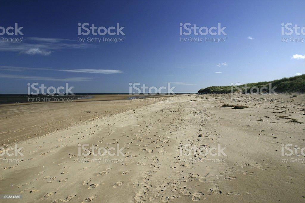 footprints on a sandy beach royalty-free stock photo
