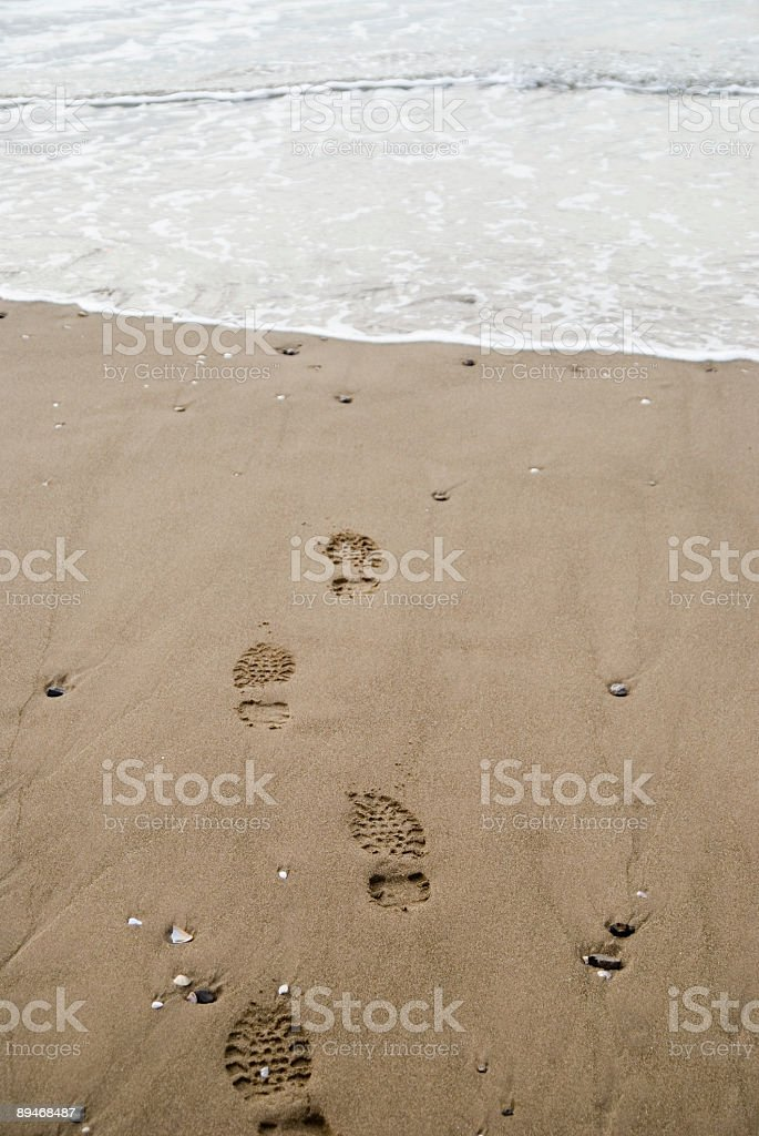 footprints on beach sand royalty-free stock photo