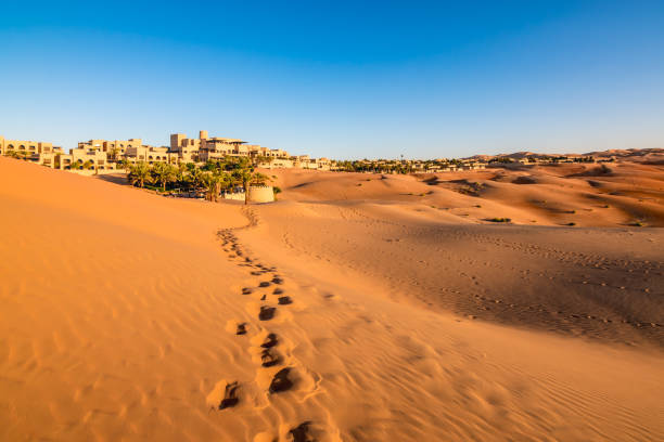 Footprints on desert sand in Abu Dhabi stock photo