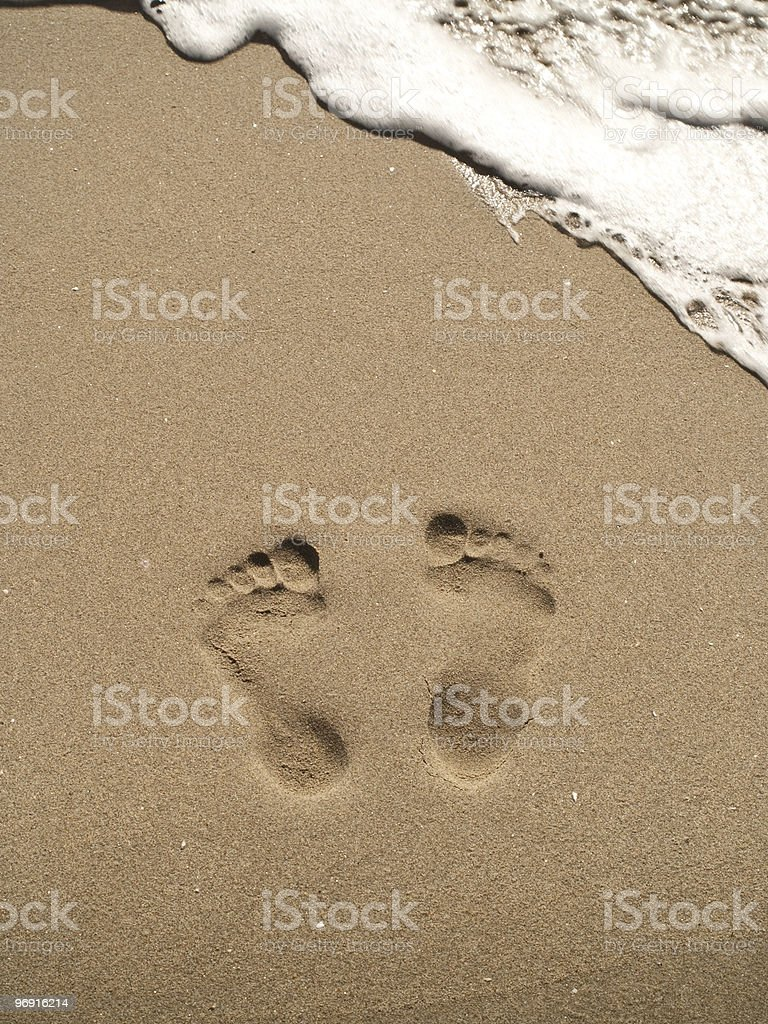 footprints on sand beach royalty-free stock photo