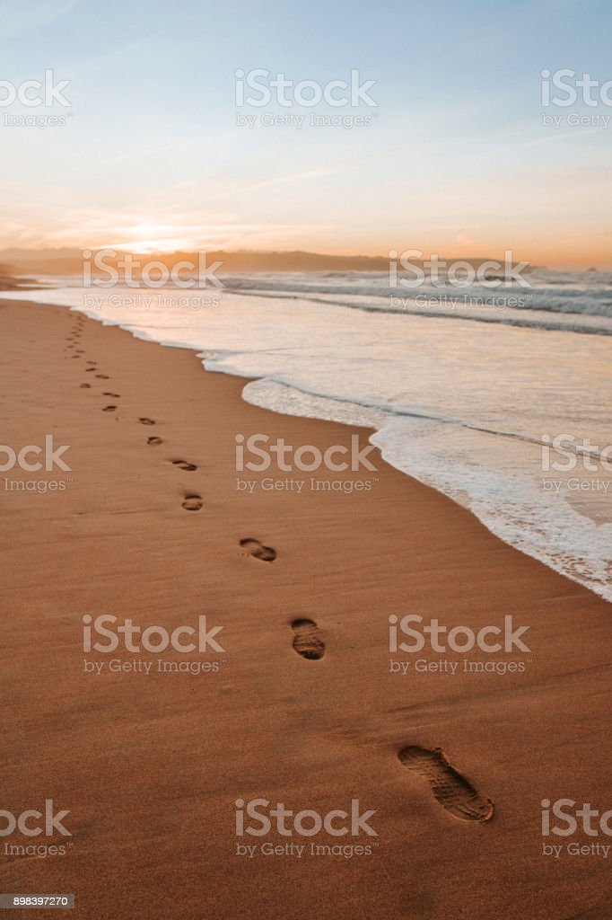 Footprints in the sand of a beautiful beach