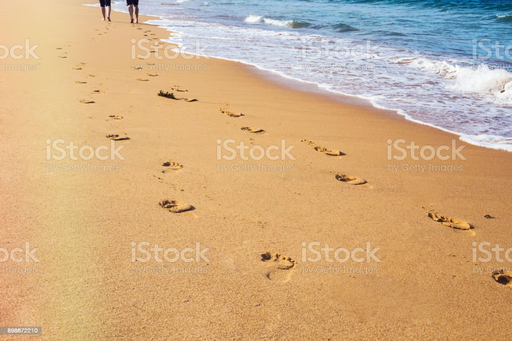 Footprints of people on the beach
