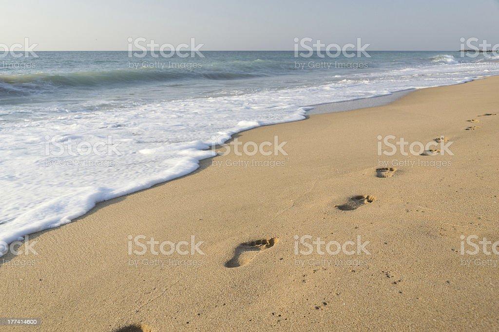 Footprints on the sand beach stock photo