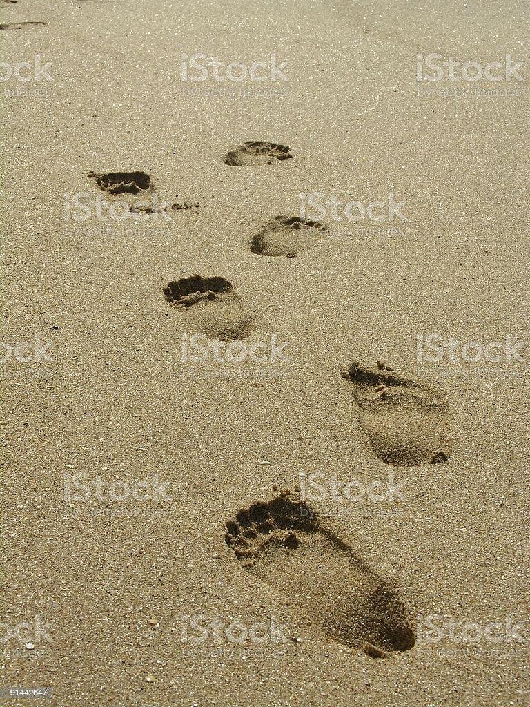 Footprints on the sand (beach) royalty-free stock photo