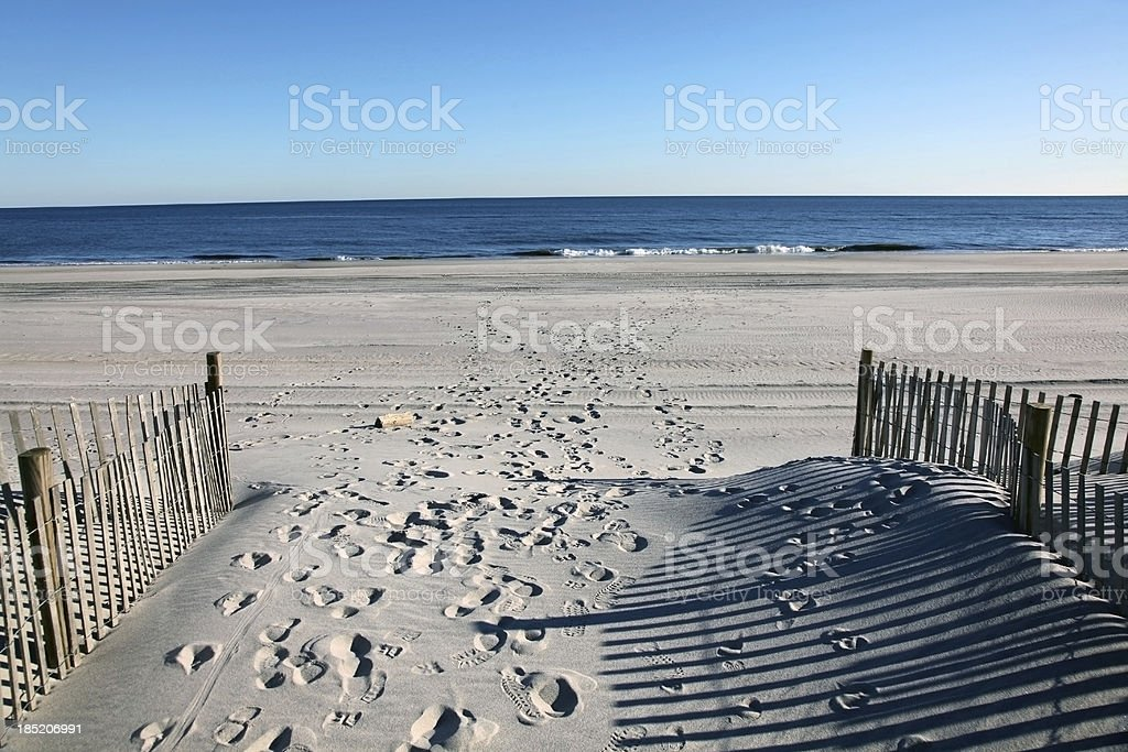 Footprints on the sandy beach at the seaside stock photo