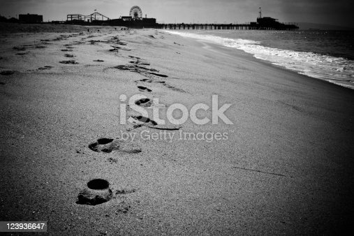 Footprints on the beach of Santa Monica, L.A. Grainy, digital noise added.