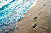 Footprints on the soft beach