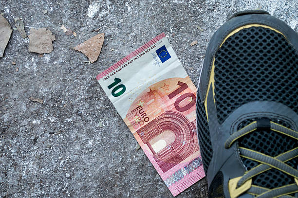 Foot/Shoe on a Ten Euro Note/Money stock photo