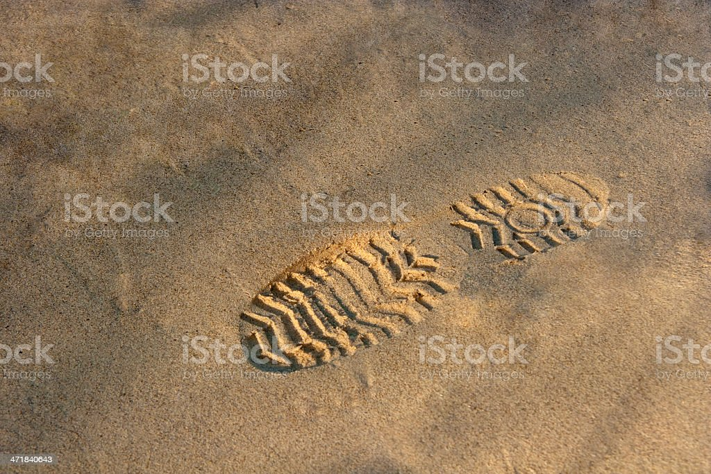 Footstep on sand stock photo