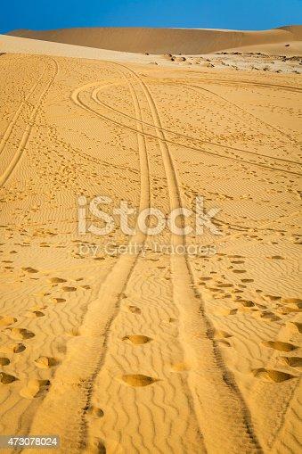 Footsteps and car tracks in White sand dune in Mui Ne, Vietnam