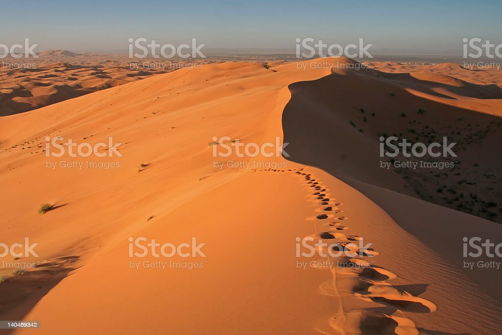 Footsteps in Erg Chebbi sand dunes royalty-free stock photo