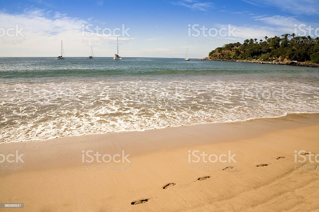 Footsteps in the sand on a beach royalty-free stock photo