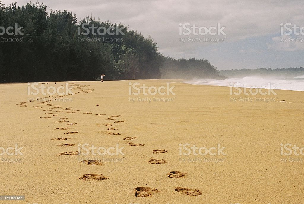Footsteps on a Kauai Hawaii Pacific ocean beach royalty-free stock photo