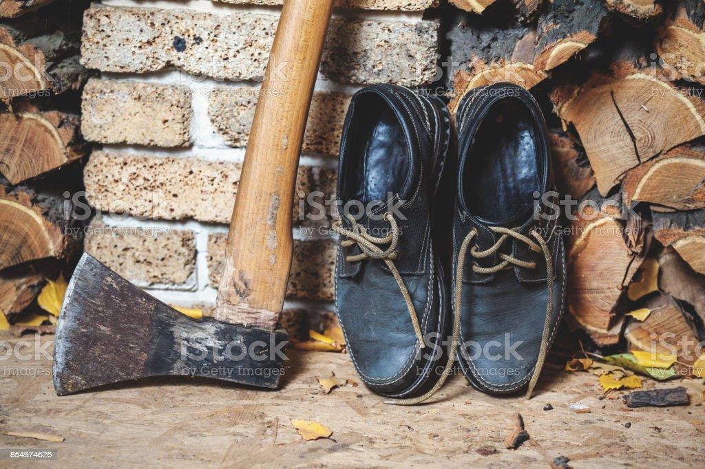 footwear lumberjack ax and firewood stock photo