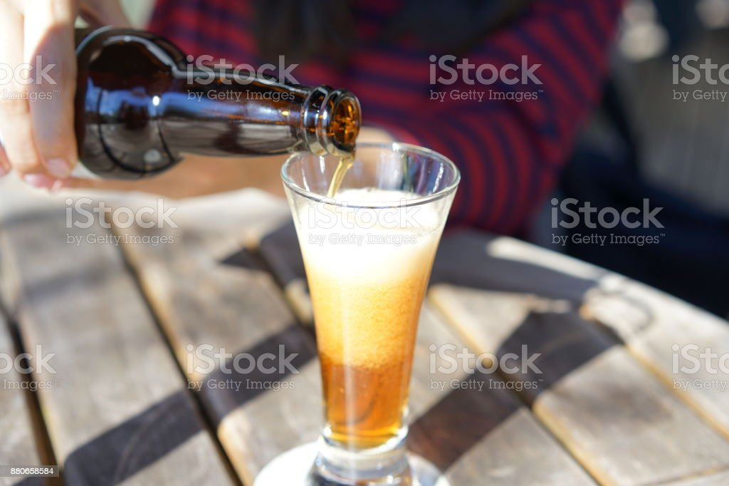 Pour a beer stock photo