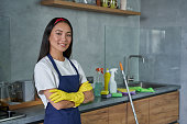 istock For a cleaner place. Portrait of pretty young woman cleaning lady wearing protective gloves, smiling at camera, ready for cleaning the house 1286012839
