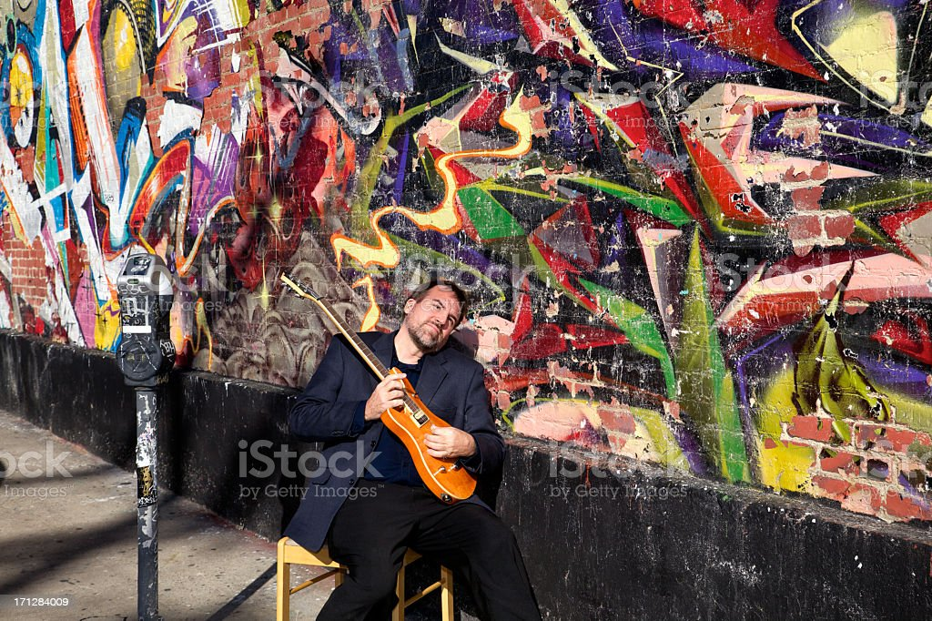 for Electric Guitarist Playing in Downtown Urban City stock photo