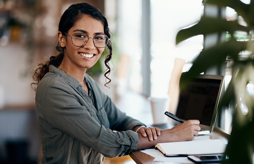 Shot of a young woman working in a cafe