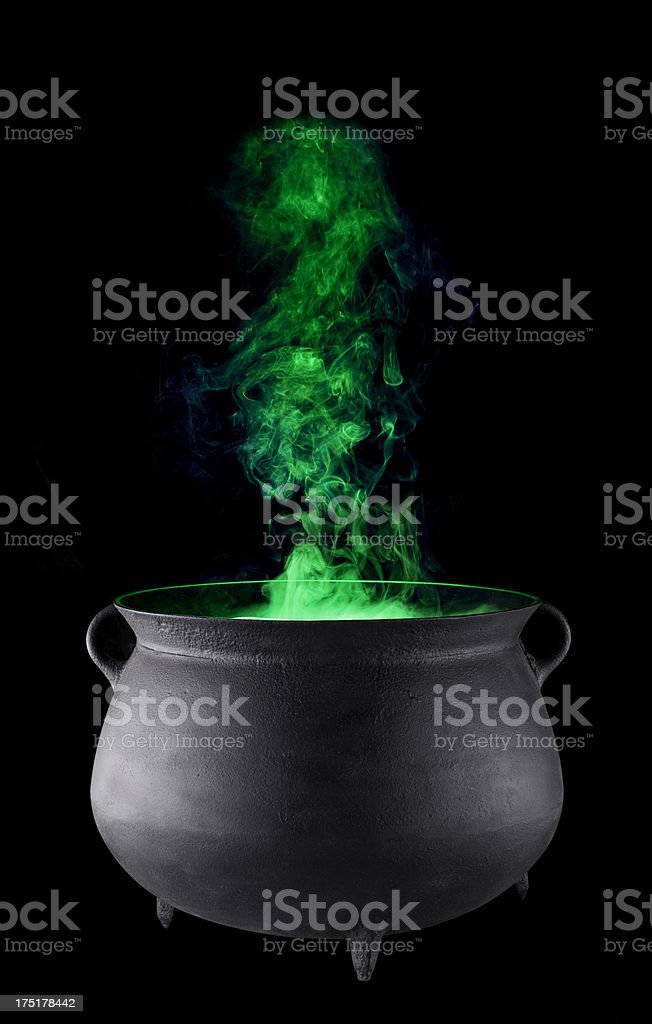 For Halloween, Witches Cauldron with Green Smoke, on Black. stock photo