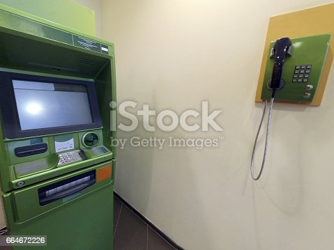 istock ATM for issuing money and the phone is green at the point of service 664672226