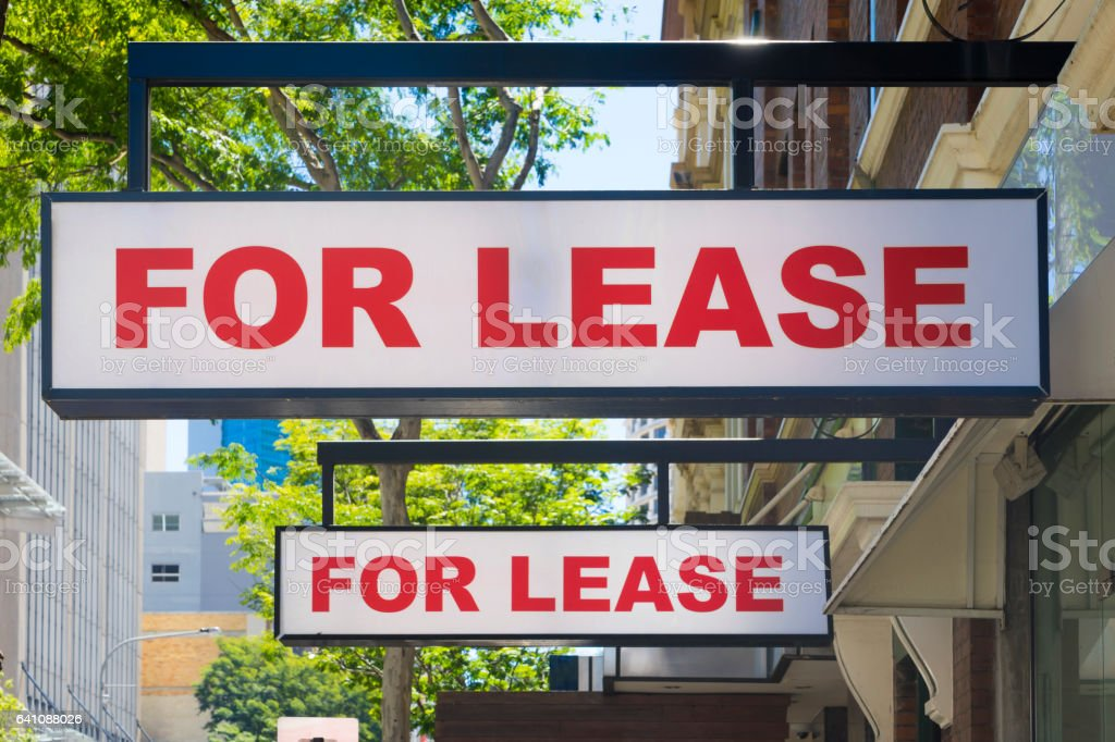 For Lease signs on display outside buildings stock photo