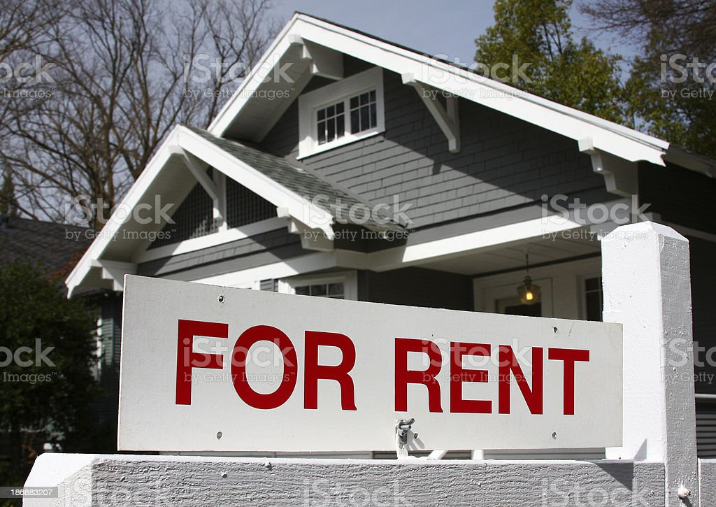 For Rent California real estate sign and house stock photo