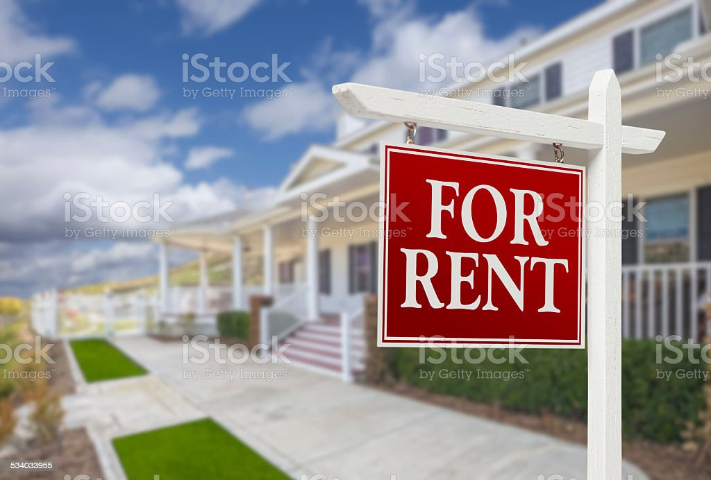 For Rent Real Estate Sign in Front of House stock photo