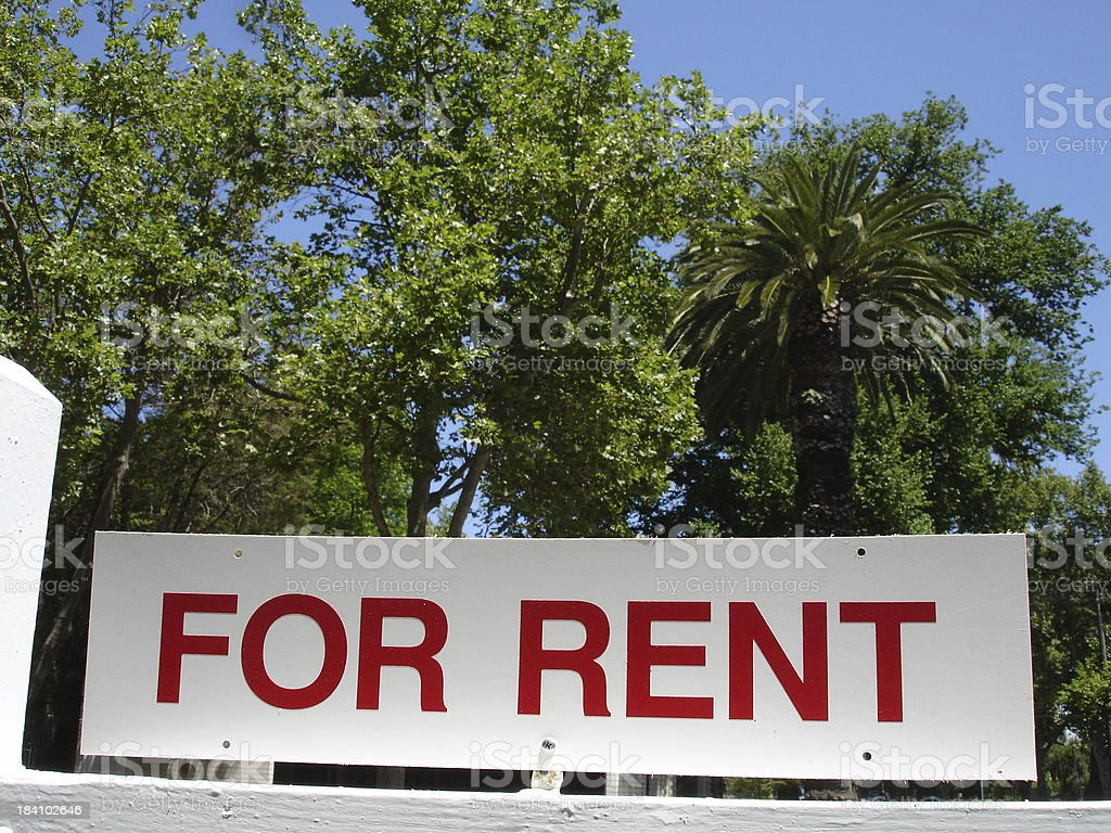 For rent sign and trees royalty-free stock photo