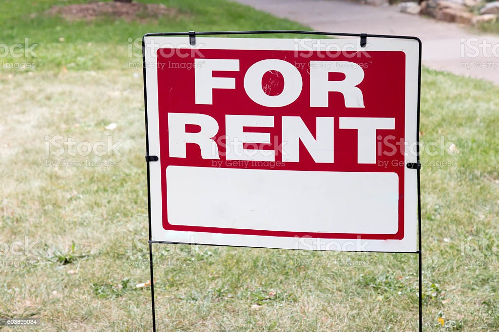 For Rent sign posted on a yard stock photo