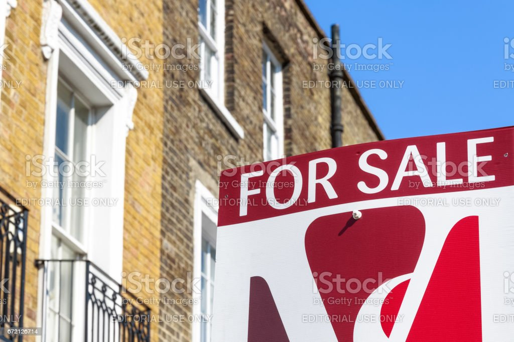 For Sale property agency sign posted outside English terraced houses in Poplar, East London stock photo