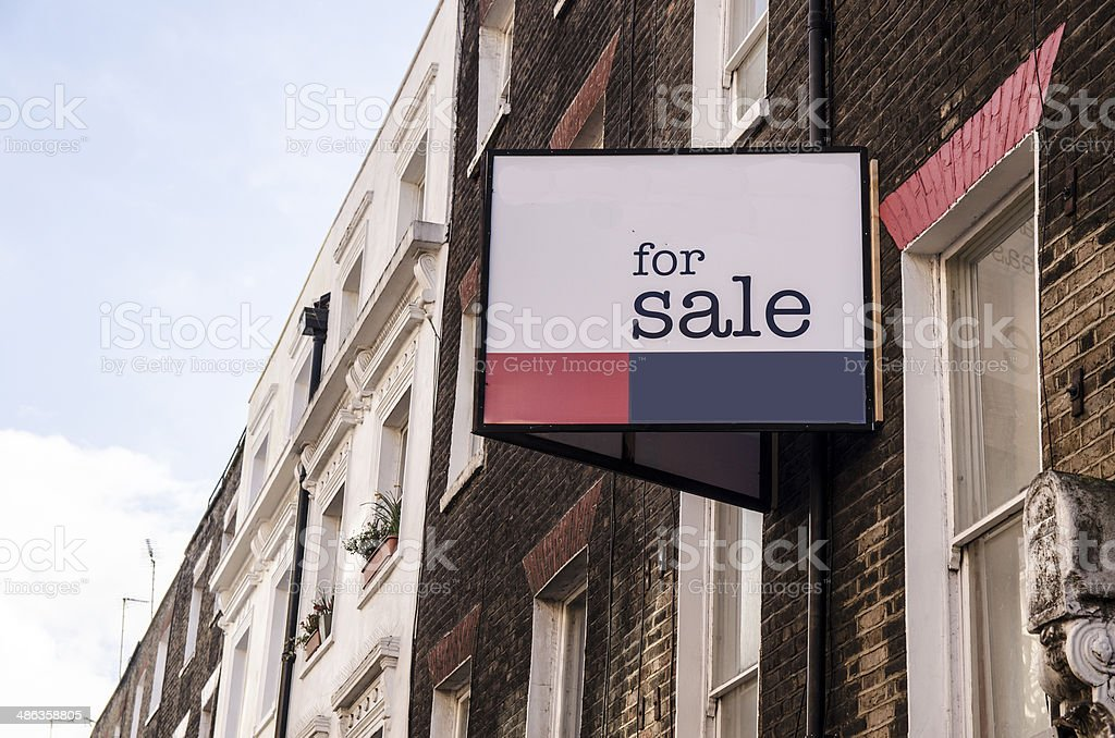 for sale sign on a building stock photo