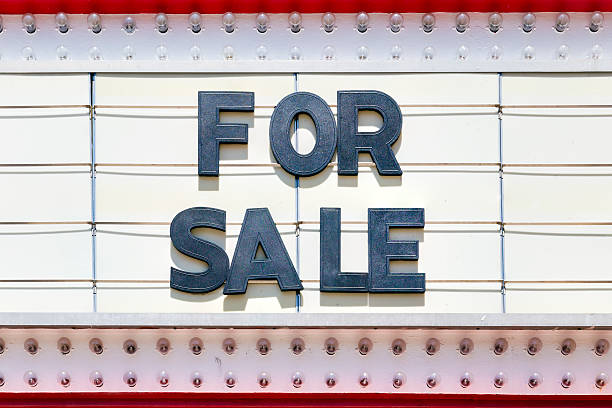 For Sale Sign on a Theater Marquee For sale sign on a theater marquee theater marquee commercial sign stock pictures, royalty-free photos & images