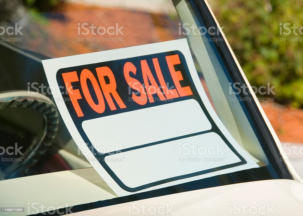 For sale sign sitting in car window stock photo