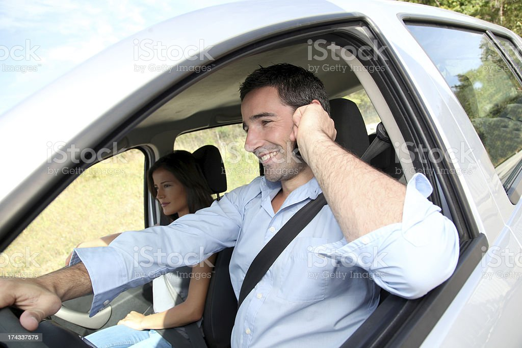 For security the man phoning in car before leaving stock photo
