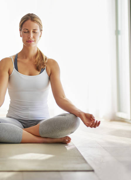 For the body and mind Cropped shot of an attractive mature woman practicing the art of meditation lotus position stock pictures, royalty-free photos & images