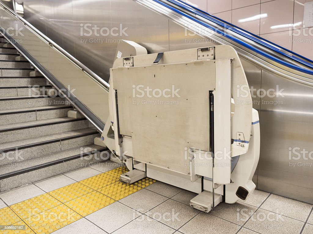 wheelchair stair lift. for the station of wheelchair stair lift stock photo p