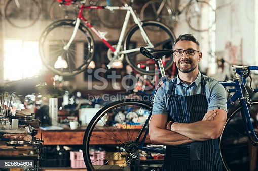 Portrait of a mature man working in a bicycle repair shop