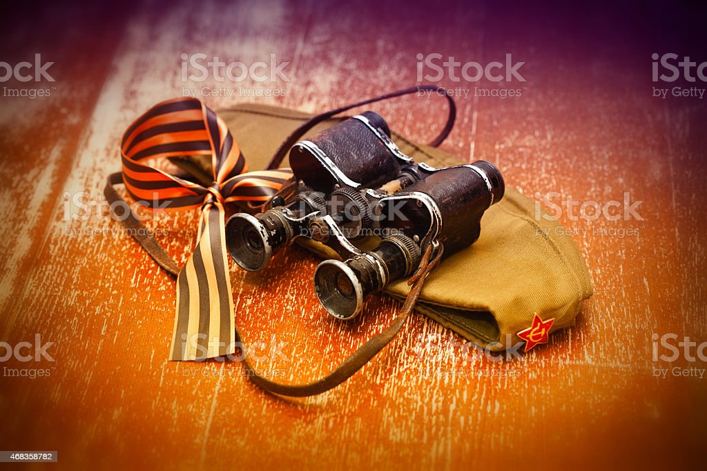 forage cap with a star, military binoculars, St. George Ribbon royalty-free stock photo