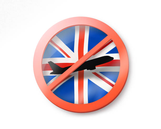 Forbbiden sign with crossed out plane on the British flag. stock photo