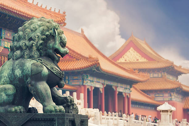 Forbidden city, Beijing Old imperial lion sculpture in front of historical Forbidden City buildings. forbidden city stock pictures, royalty-free photos & images