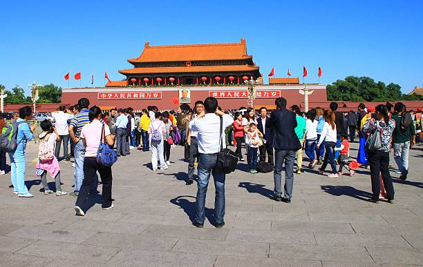 Forbidden City entrance Beijing, China - September 29, 2012: Forbidden City entrance with famouse Tien An Men Gate. Crowd of tourists in foreground, Mao Tse Tung portrait in background mao tse tung stock pictures, royalty-free photos & images