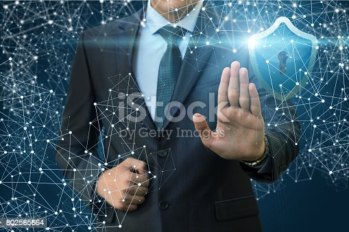 istock Forbidden gesture of the businessman to protect the network . 802565664