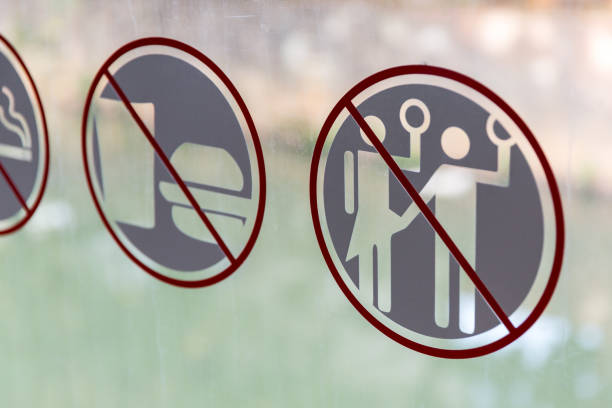 Forbidden to sexually intimidate women in the bus in Jakarta Forbidden to harass, violate or sexual intimidate women sign on the public transportation bus in Jakarta, Indonesia prettige verrassingen stock pictures, royalty-free photos & images