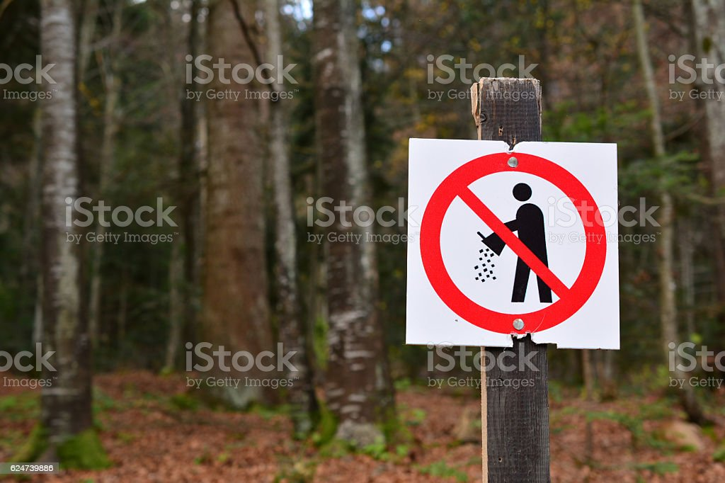 Forbiden littering sign in the forest stock photo