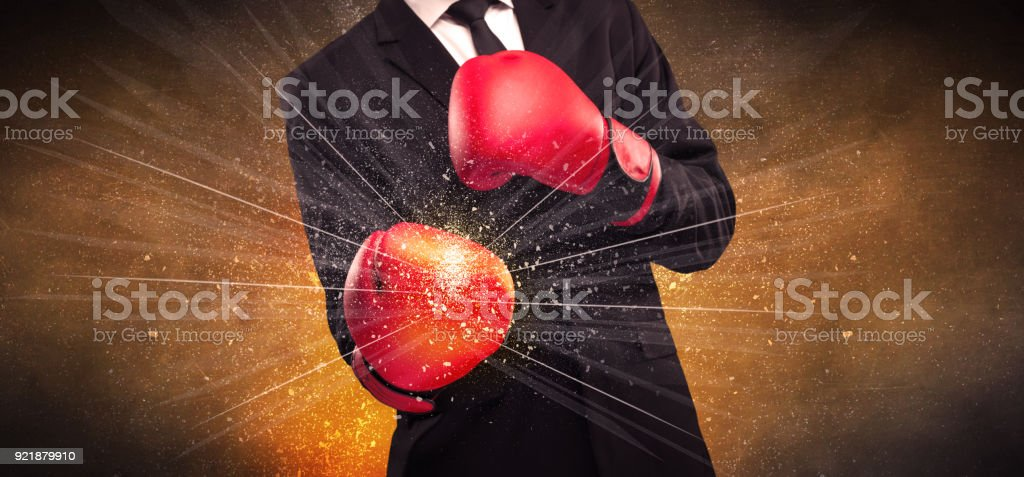 Forceful businessman boxing stock photo