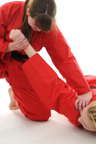 Martial artist executing a takedown.