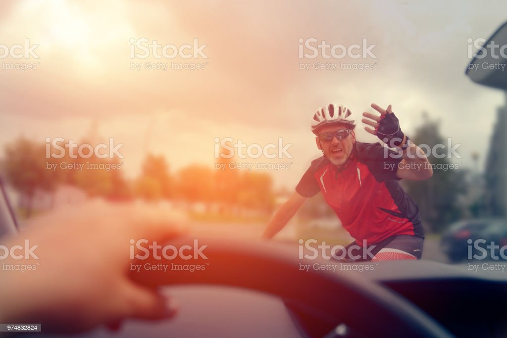 Forcing the right of way on the road stock photo